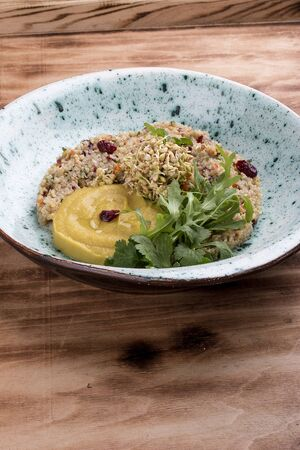 Quinoa with hummus and arugula