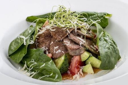 Salad with veal tongue, quinoa and avocado. On white background