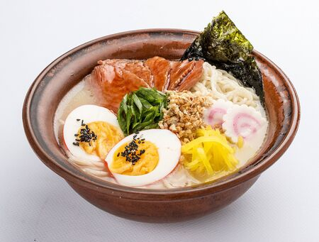 Japanese ramen soup with veal, egg, chives and sprout on white background. Imagens