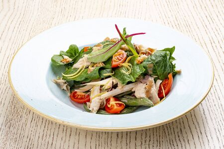 Mix salad with chicken and tomatoes. On light background