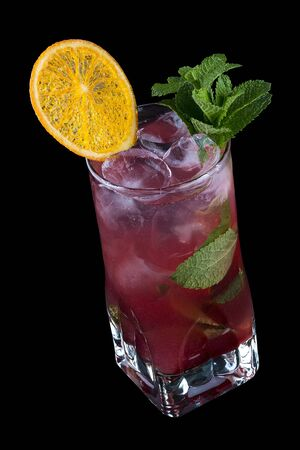Raspberry Mojito decorated with orange chips. On black background