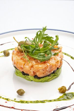 Tartar with salmon with arugula and avocado mousse
