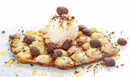 Bubble waffles with ice cream and chocolate chip cookies. On white background 스톡 콘텐츠