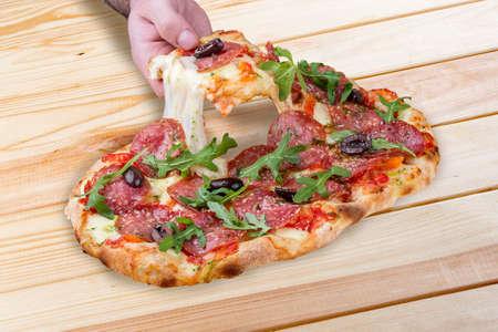 Roman pizza. Diavolo pinza with chorizo, jalapeno and kalamata olives