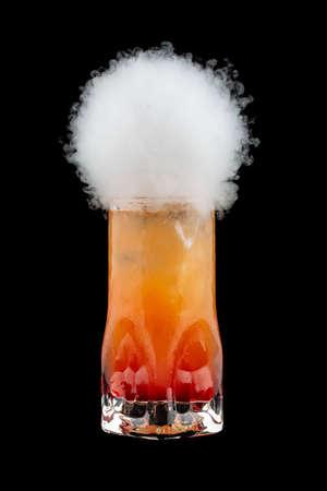Smoke bubble orange cocktail on black background. Bubble burst. Isolated Фото со стока