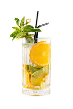 Lemonade with orange and lime on a white background. Isolated