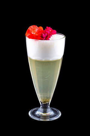 Pear cocktail, decorated with flowers on a dark background. Isolated Фото со стока