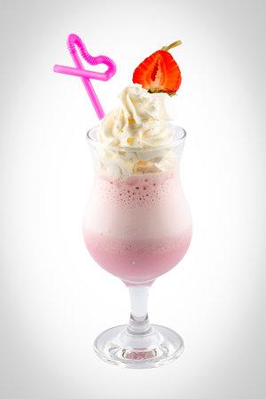 Strawberry milkshake with cream on a white background. Isolated