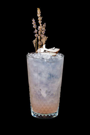 Lavender and coconut cocktail on a dark background. Isolated