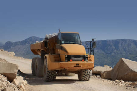 dimension: heavy dump truck working in dimension stone mine