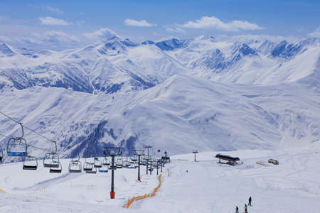 station ski: Panoramic view on ski station on snowy mountains background Stock Photo