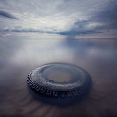 long exposure: the Wheel in water with long exposure on storm background Stock Photo