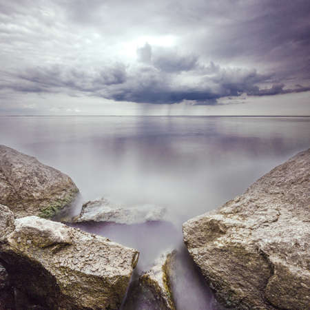 long exposure: the Stones in water with long exposure on storm background