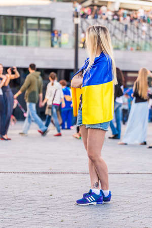 cute tattoo: KYIV, UKRAINE - JUNE 21: Girl in ukranian flag with cute tattoo on the leg during concert of Okean Elzy on JUNE 21 2014 in NSC Olimpiyskiy. Final concert of world tour named 20 years together» on JUNE 21 2014 in Kyiv, Ukraine