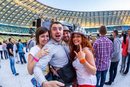 olimpiyskiy: KYIV, UKRAINE - JUNE 21: Cool fans on concert of Okean Elzy on JUNE 21 2014 in NSC Olimpiyskiy. Final concert of world tour named 20 years together» on JUNE 21 2014 in Kyiv, Ukraine
