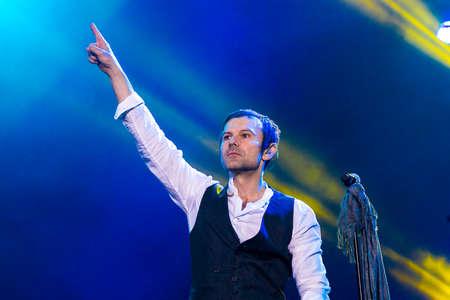 olimpiyskiy: KYIV, UKRAINE - JUNE 21: Svyatoslav Vakarchuk on concert of Okean Elzy on JUNE 21 2014 in NSC Olimpiyskiy. Final concert of world tour named 20 years together» on JUNE 21 2014 in Kyiv, Ukraine Editorial