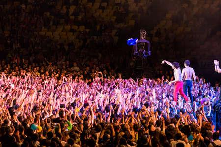 olimpiyskiy: KYIV, UKRAINE - JUNE 21: Svyatoslav Vakarchuk and crowd on concert of Okean Elzy on JUNE 21 2014 in NSC Olimpiyskiy. Final concert of world tour named 20 years together» on JUNE 21 2014 in Kyiv, Ukraine Editorial