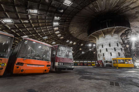 Abandoned bus depot with amazing construction circus and colored buses