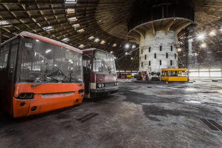depot: Abandoned bus depot with amazing construction circus and colored buses