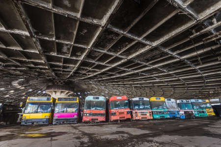 Colored buses in abandoned bus depot