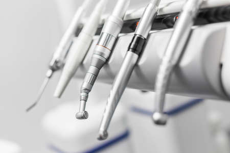 gripper: Closeup of a modern dentist tools, burnishers with blurred background
