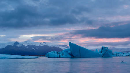 Icebergs floating in Fjallsarlon glacier lake at sunset. South Iceland.Close to Jokulsarlon lagoon. Icebergs floating in Fjallsarlon glacier lake at sunset.