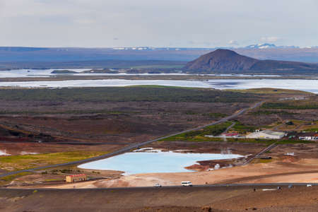 Hverir geothermal area in the north of Iceland near Lake Myvatn, with geothermal lake, looking like Blue Lagoon, Hot Mud Pots and great landscape in the Geothermal Area Hverir, summer day. Stock Photo