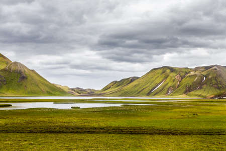 Green landscape with lake and hills in Iceland