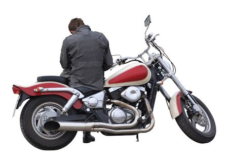 insular:  Color photo of a large heavy motorcycle with a driver