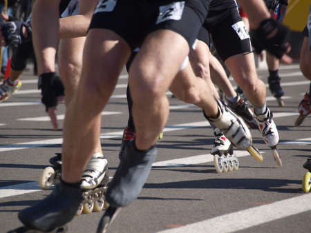 participants:        Color photograph runners on roller skates. Participants in the competition. Stock Photo