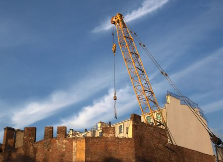 Color photograph cranes in the background of an old brick wall       Stock Photo - 5074591