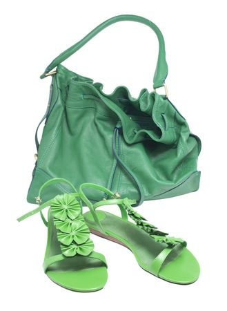 color photo of womens sandals for summer recreation and green bags         photo