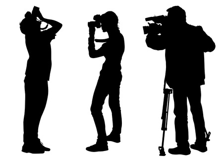 Vector graphic cameraman at work. Isolated silhouette on a yellow background Vetores