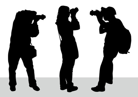 paparazzi: image of young photographers with equipment at work