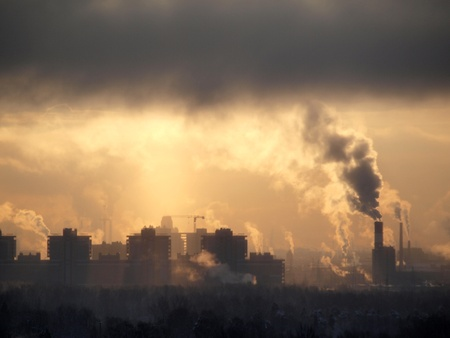 smog: Color photograph of industrial buildings at sunset