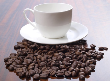 Color photo of coffee beans and a white cup        Stock Photo - 8661106