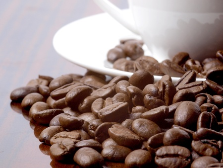 Color photo of coffee beans and a white cup        Stock Photo - 8661107