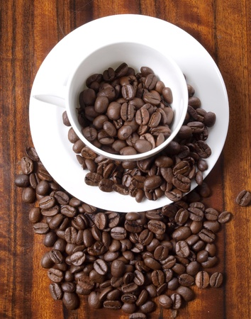 Color photo of coffee beans and a white cup Stock Photo - 8661112