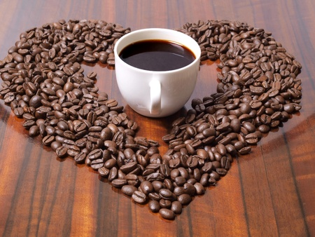 Color photo of coffee beans and a white cup        Stock Photo - 8661111