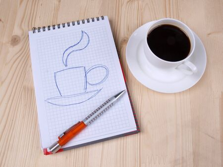 Color photo of paper page and a white cup         Stock Photo - 8661129
