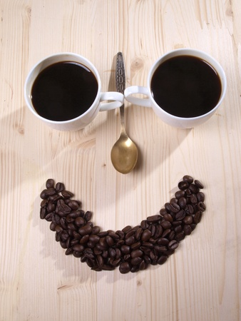 Color photo of coffee beans and a white cup Stock Photo - 8661133