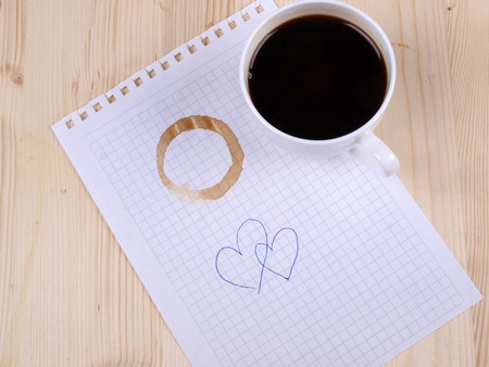 Color photo of paper page and a white cup Stock Photo - 8661130