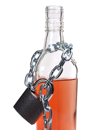 alcoholic beverages: Color photo of wineglass of whiskey and metal chain