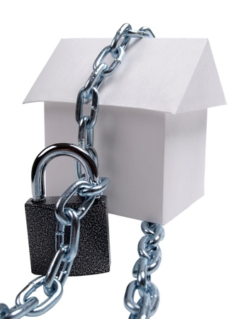 paper model house and padlock       photo