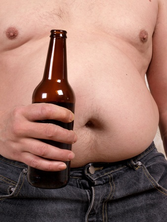 a fat man with a beer       photo