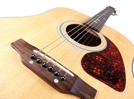 playing folk: acoustic guitar on white background        Stock Photo
