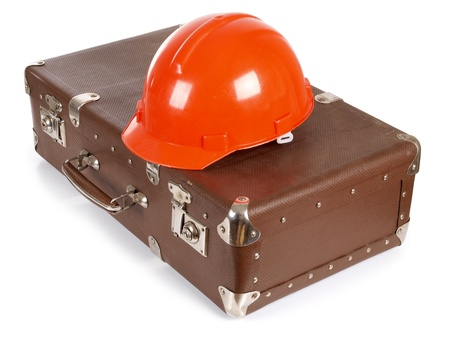 casque: an old suitcase and construction helmets
