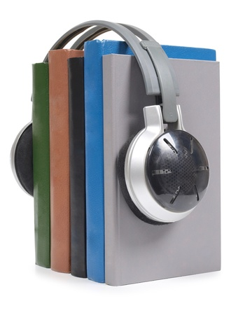 audio book: Color photo of a stack of books and headphones      Stock Photo