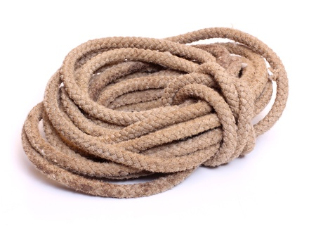 Color photo of a coil of rope on a white background