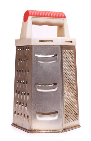 cooking implement: Color photo of a metal grater for food